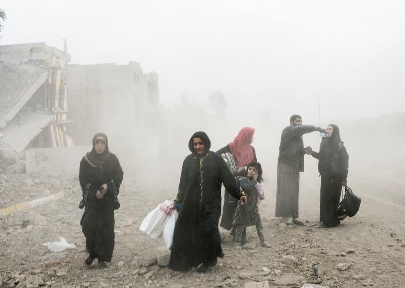 IRAQ. Mosul. March 2017. Civilians fleeing from Mosul