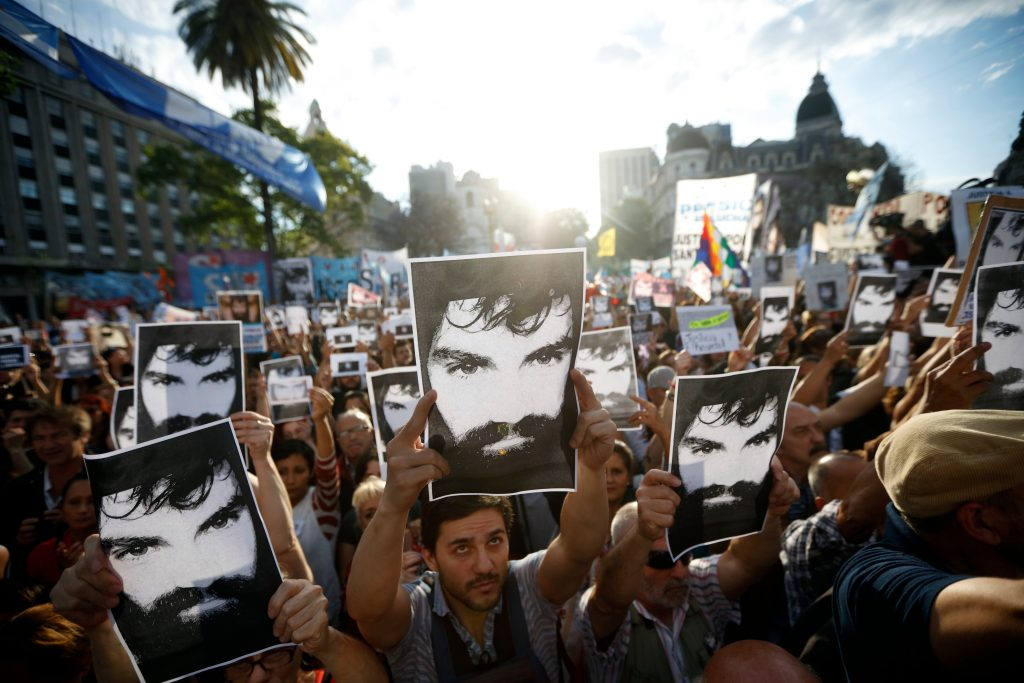 Demonstrators take part in a march to demand justice for late activist Santiago Maldonado at Plaza de Mayo square in Buenos Aires on November 1, 2017, three months after his disappearance. Maldonado disappeared on August 1st during a Mapuche protest in Chubut province and was found dead 79 days after.