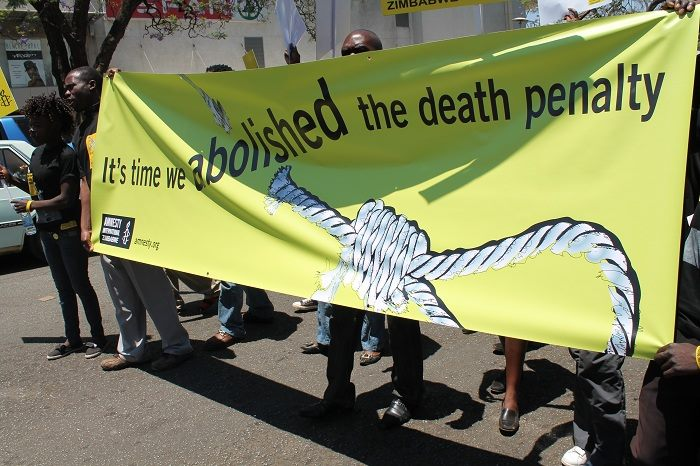 Amnesty International Zimbabwe activists march through the capital Harare to peacefully protest against the death penalty on World Day Against the Death Penalty.  Events took place in the city that day including a rally under the title - Time to abolish the death penalty in Zimbabwe. Justice minister Emerson Mnangagwa spoke at the rally. Death Penalty Day that falls on October 10 every year, is meant to encourage states to adopt the principle that 'the use of the death penalty undermines human dignity'.