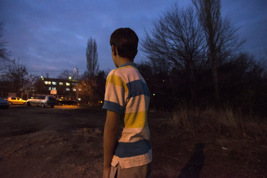 Imran Suelhan, 11, from Afghanistan is unaccompanied minor who is living in the Reception Center for Asylum Seekers - Ovcha Kupel situated in the Bulgarian capital Sofia on November 16, 2016. He is seen to pose for image looking towards the Reception Center building where he lives now.